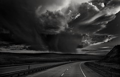 gonna slip on by... please... (Alvin Harp) Tags: sonyilce7m2 fe24240mm wyoming may 2015 stormclouds highway i80 naturespower cloudsstormssunsetssunrises monochrome bwclouds bwlandscape bw alvinharp