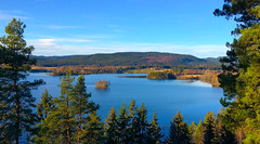Lake Scenery (bjorbrei) Tags: water lake shore blue forest hills trees spruces countryside fall autumn maridalen maridalsmannet oslo norway