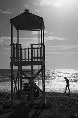 At the beach (tzevang.com) Tags: bythesea beach bw bwseascape greece clouds shilouette piraeus walking