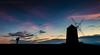 Tilting At Windmills (ianrwmccracken) Tags: morning d750 silhouette eastneuk nikon sunrise dawn fife sky windmill scotland coast stmonans cloud colour pink blue photographer person figure