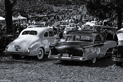 Car show (Thad Zajdowicz) Tags: zajdowicz rockville maryland usa outdoor outside automobile car vehicle transportation object canon eos 7d dslr digital availablelight lightroom ef50mmf12lusm 50mm primelens blackandwhite monochrome black white grey gray bw cars automobiles vehicles classic carshow people vintage tree building montgomerycounty