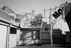 R1-042-19A (David Swift Photography) Tags: davidswiftphotography newjersey wildwood boardwalk amusements ferriswheel closed signs closedfortheseason 35mm film ilfordxp2 olympusstylusepic waterparks amusementparks
