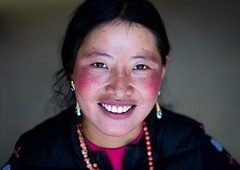 Portrait of a smiling tibetan nomad woman with her cheeks reddened by the harsh weather, Qinghai province, Tsekhog, China (Eric Lafforgue) Tags: 2025years asia asian asianethnicity beautifulpeople china china17339 colourimage ethnicity frontview headshot horizontal huangnan lookingatcamera necklace nomad nomadic oneadultonly onepersononly onewomanonly people portrait posing qinghaiprovince smiling tibet tibetan tibetanautonomousprefecture tongren travel tsekhog women worldtravel zekog chn