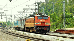 Colorful LHB Rake of Humsafar Express curving into Tyakal (sriguru05) Tags: railfanning raildrishti indianrailways locomotive trainspotting railroad train engine track panasonic lumix fz300 4k electric lhb colorful humsafar erode ed wap4 bengaluru cantt cantonment bnc kamakhya kyq express curve tyakal tcl