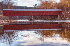 West Cornwall Covered Bridge (iecharleton) Tags: coveredbridge bridge westcornwall westcornawallcoveredbridge autumn newengland housatonicriver latticetruss reflection river antique woods sky hdr