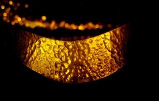 bangle, lit by candlelight