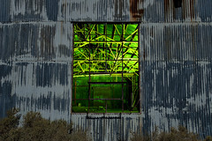 corrugated. mojave desert, ca. 2016. (eyetwist) Tags: eyetwistkevinballuff eyetwist night abandoned window ruins yellow green windowframe corrugated wall moonlight gold mill mine mining urbex mojavedesert nikon nikond7000 d7000 nikkor capturenx2 1024mmf3545g fullmoon photography desert arid dark longexposure moonlit gel npy nocturne highdesert mojave california long exposure wideangle stars startrails light painting lightpainting forgotten ruin decay architecture building warehouse exploring saturated industry industrial rock tungsten glass shattered broken graphic girders beams supports
