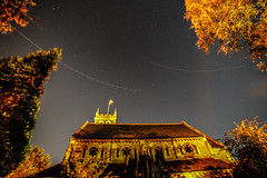 flight of the angels (Paul Wrights Reserved) Tags: church churchyard night nightphotography astrophotography astro flag tower belltower roof building exterior trees sky landscape skyscape nighttime plane planes aeroplane movement swerving flight inflight flightpath essex stars star