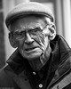 Hats and hearing aids. (Neil. Moralee) Tags: neilmoralee neilmoraleenikond7200rain old mature man senior citizen pensioner pension tired alone hat glasses isolation age cap wrinkles stress despair depression hearing aid deaf deafness cold wet walk black white mono monochrome bw bandw blackandwhite nikon d7200 neil moralee people taunton somerset rain raining