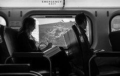 Metra Passengers (Jovan Jimenez) Tags: metra passengers woman girl glasses train people black white gray samsung smg935t galaxy s7 edge rear camera mobile monochrome monochromatic chicago window ride interior
