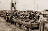 Herring Gutting, Gt Yarmouth (footstepsphotos) Tags: yarmouth norfolk herring fish gutting fishing industry girls ladies barrel workers old vintage postcard historic england