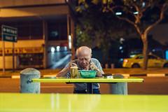 Dinner and Solitude (Jon Siegel) Tags: nikon d810 man elderly people candid street night evening singaporean singapore teh tea dinner dining late sigma 50mm 14