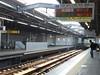 Waiting for the train (seikinsou) Tags: japan osaka autumn hanshin railway train station platform