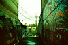 Alley Way Reflections (Georgie_grrl) Tags: graffiti streetart creative colourful expression toronto ontario pentaxk1000 rikenon12828mm crossprocessedfilm velviaasa50