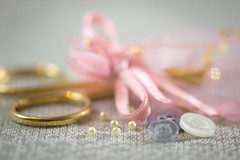 'buttons and bows' for macro mondays (Emma Varley) Tags: buttonsandbows macromondays buttons bow ribbon giftbag scissors gold pink beads pearl pretty soft romantic sewing needlecraft craft