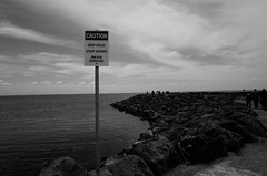 Welcome! (Latecomer (4tunesphotos)) Tags: bw sea seascape seawall welcome danger