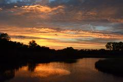 Happy Ending (NaturalLight) Tags: sunset water reflections chisholmcreekpark wichita kansas