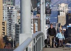 Crossing The Granville (Clayton Perry Photoworks) Tags: vancouver bc canada fall autumn explorebc explorecanada skyline granvillestreetbridge bridge people wheelchair