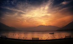 first row view (Chrisnaton) Tags: switzerland tenero campingtamaro lake lagomaggiore eveningmood eveningcolors eveningsky benches lakeside ducks landscape firstrowseats raft
