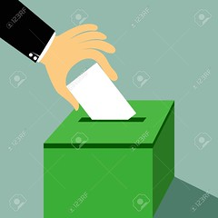 Cartoon hand inserting a paper ballot voting on a ballot box vector illustration. (WWTMVFAPSGY6N4OPFVNZF3KBB4) Tags: ballot vote box voting election hand registration voter paper background government political casting referendum choice politics polling white man symbol democracy questionnaire document insert democratic balloting party poll idea solution decision mail letter bulletin peace business team