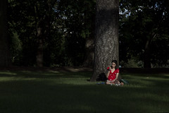 Eve. (Ranga 1) Tags: australia australian australianlandscape streetphotography candid candidgirl victoria melbourne carltongardens park carlton red apple thinking thought eating eve summer heat trees relaxing canon canoneos5dmarkiii ef24105mmf4lusm davidyoung explore