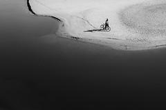 making tracks (Marc McDermott) Tags: person man bike bicycle walking beach river water sand shadow tracks blackandwhite shore