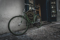 Absintherie (mirri_inc) Tags: prague europe absinth bike bicycle green white wall street shop entrance sony travel