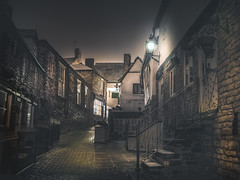 Stamford (unciepaul) Tags: stamford night time snow falling longexposure streetlight doors lights cobbles walkway december winter colour texture split toning