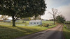 Morning Has Broken.jpg (TuthFaree) Tags: morning light amish horse buggy schoolhouse playground rural country farm tree mthope ohio fence pavement curve