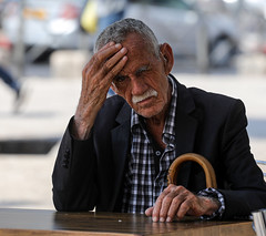 It's not good for man to be alone by: Natan Zach (ybiberman) Tags: israel jerusalem oldcity alquds muslimquarter damascusgate man old cane walkingstick wrinkles hearingaid mustache candid streetphotography