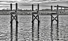 Dock #14:  Keeping it Close (brev99) Tags: d610 barrington tamron28300xrdiif rhodeisland dock blackandwhite tonality macphun photos photoshopelements12 dxofilmpack5 topazdenoise reflections sunsetlight sunset