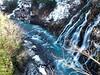 "Also known as the ""White Beard Waterfall,"" this cascading water turns cobalt blue in the basin. (siew_wei) Tags: travel falls autumn river ilovenature blue shirahigewaterfall japan hokkaido biei whitebeardwaterfall saveearth waterfall"