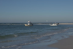 Bait fishing, high-tech (nrparsons) Tags: fishing gulfofmexico lidobeach sea boat water ocean sky gulf beach wave sand people