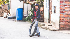 Untitled (#Weybridge Photographer) Tags: canon slr dslr eos 5d mk ii nepal kathmandu asia mkii phutung boy child tyre play paying tire