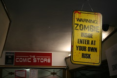 Warning, Comical Zombies (Canis Major) Tags: zombies sign glastonbury comicstore warning risk