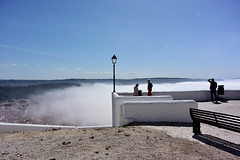 Nazare, Portugal (Marian Pollock) Tags: europe portugal nazare mist city hill silhouettes people fromabove lookout sunshine outdoor weather fence water