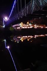 under the bridge (Sundornvic) Tags: river reflection severn shrewsbury shropshire light night riverbank bridge boathouse