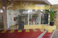New store opened this day (D70) Tags: new store opened this day shop market minimarket lrminimarket advertising turtle inflatable tire tyre wheel november22 2017 water cans pop softdrinks
