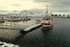 Fishing boats moored in the port-Festvagtinden mounts background. Laukvik-Vagan kommune-Austvagoya-Lofoten-Norway.0623 (rweisswald) Tags: fishingboat fishingport basin moorage moored mooringline floatingpontoon dock pier berth quay wharf jetty spar foremast mainmast mizzenmast rig rigging fishingtackle shipsbow boatdeck superstructure port starboard fishingbuoy bluesail redlifesaver woodenrack aframe scaffolding hjell dryer cod drying hanging stockfish overcast snowy snowcovered snowcappedmountain festvagaksla festvagtinden hallvarlitinden laukvik vagankommune austvagoya lofoten nordlandfylke norway