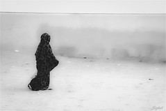 Passerby (Sebastian Sighell) Tags: blackwhite monochrome streetphotography rural travel morocco woman sahara sony