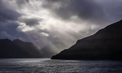 Do you see the light? (katrin glaesmann) Tags: unterwegsmiticelandtours photographyholidaywithicelandtours clouds atriptoremember wherestrangersbecomefriends atsea light sunrays islands faroeislands faroes