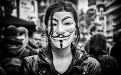 the girl in the anonymous mask (Daz Smith) Tags: dazsmith fujixt20 fuji xt20 andwhite city streetphotography people candid portrait citylife thecity urban streets uk monochrome blancoynegro blackandwhite mono mask girl guyfawkes crowd london anonymous demonstrate