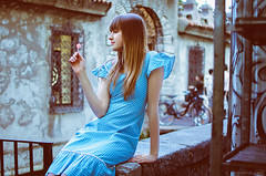 An Afternoon with Blanka (Michela Riva Photography) Tags: portrait girl city people retro street europe vintage urban fashion emotions woman youth cute happiness model alone candy young blonde long hair moody photography emotional teenager cold colors cinematic blue dress lollipop italy
