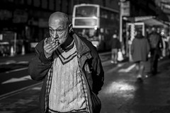 To The Bitter End (Leanne Boulton) Tags: portrait urban street candid portraiture streetphotography candidstreetphotography candidportrait streetportrait streetlife sociallandscape old man male face facial expression elderly eyes look emotion feeling mood smoke smoker smoking cigarette grime dirty character tone texture detail depthoffield bokeh naturallight outdoor sunlight light shade shadow city scene human life living humanity society culture people lifestyle canon canon5d 5dmkiii 70mm ef2470mmf28liiusm black white blackwhite bw mono blackandwhite monochrome glasgow scotland uk