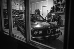 Garage Hangs (dakotastone1) Tags: garage classiccars blackandwhite window bmw e30 dirtywindow