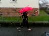 Crimson umbrella (A. Yousuf Kurniawan) Tags: red umbrella crimson walkway walking rainy drizzle droplet water people streetphotography urbanlife cameraphone cameraphonestreet phonestreet blur decisivemoment