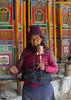 Tibetan pilgrim woman with a prayer wheels in her hand in Labrang monastery, Gansu province, Labrang, China (Eric Lafforgue) Tags: 6065years amdo asia asian buddhism china china17474 colourimage day inarow khor kora labrang labulengsi largegroupofobjects lookingatcamera maniwheel monastery oneadultonly onepersononly onewomanonly pilgrim pilgrimage placeofworship portrait prayerwheels religion religious religioussymbol spirituality temple tibet tibetan touristdestination tradition traditionalclothing tranquility typical vertical waistup wheel women worldtravel xiahecounty gansuprovince chn