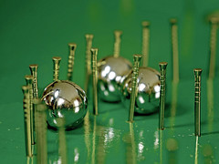 175 = 2x70 + 35 (jesse1dog) Tags: macromondays gamesgamepieces bagatelle brass pins green board balls ballbearings macro gm1 extensiontubes russian jupiter9 175 75 35 score pockets reflections bent straight bokah