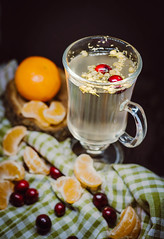 Camomile and Hot Tangerine Drink (wuestenigel) Tags: glass black cup foodphotography antioxidant season berries water delicious beverage softdrink cafe background tea light closeup cranberries drink wild liquide studio camomile tablecloth seasing afternoon style tangerines fruits hot healthy wooden glas fruit obst food lebensmittel noperson keineperson health gesundheit sweet süss gesund breakfast frühstück köstlich table tabelle homemade hausgemacht berry beere nahansicht getränk apple apfel tasse desktop nutrition ernährung traditional traditionell refreshment erfrischung