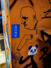 Unhand Me, You Brute (Steve Taylor (Photography)) Tags: hnrx panda face head hand arm decapitated graffiti sticker streetart brown blue black man uk gb england greatbritain unitedkingdom london outline texture